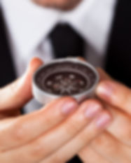 Businessman looking at a compass which h