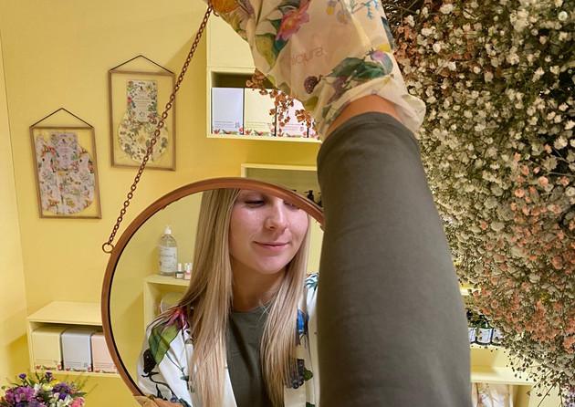 Flower Hand  Gloves on model holding Mirror.jpeg