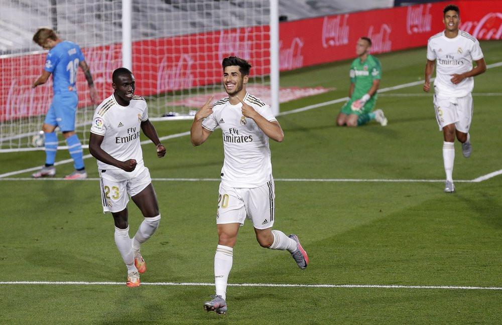 Asensio celebrating his goal against Valencia