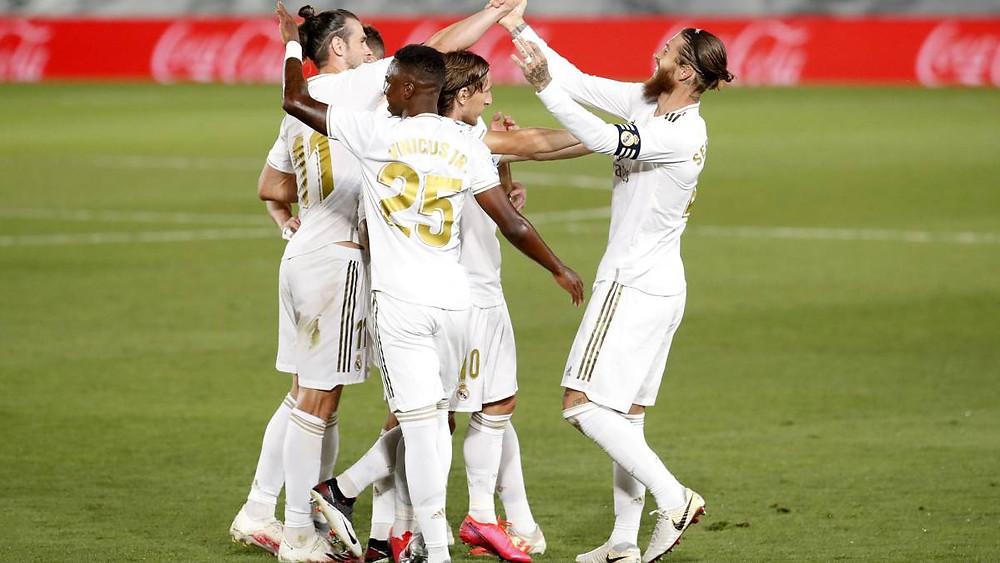 Real Madrid players celebrating Ramos goal