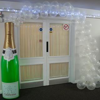 champange bottle arch