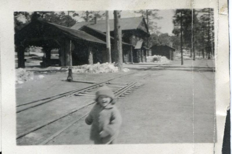 My aunt playing in front of the station, not long after Arizona became a state
