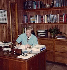 Dr. Johnson at desk in 1980s