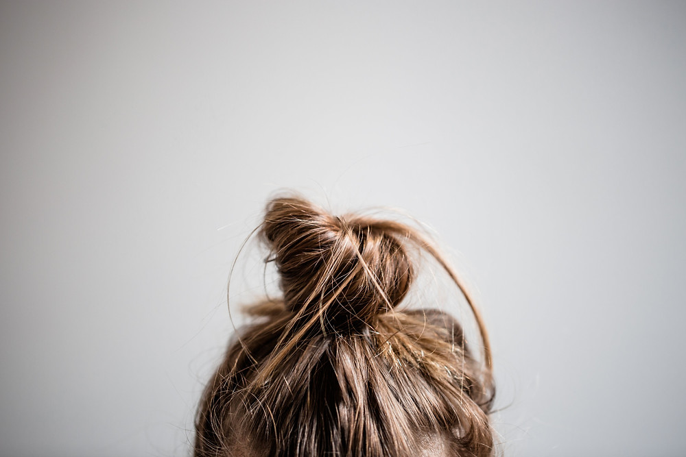 Messy hair in a bun