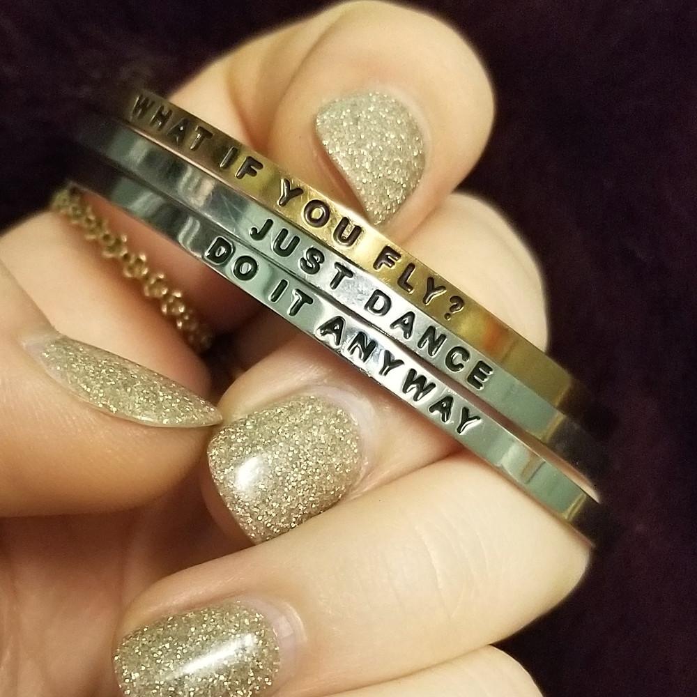 hands holding bracelets