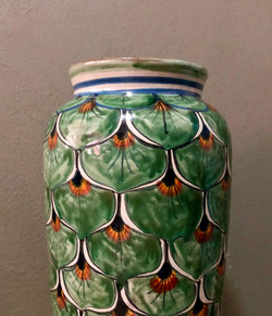 Green peacock feather clay vase