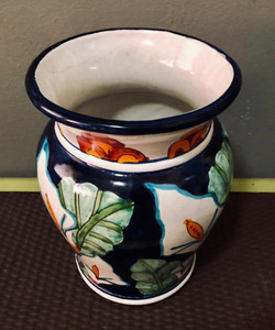 White and blue floral clay vase