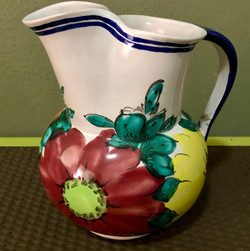 Red and yellow floral clay pitcher