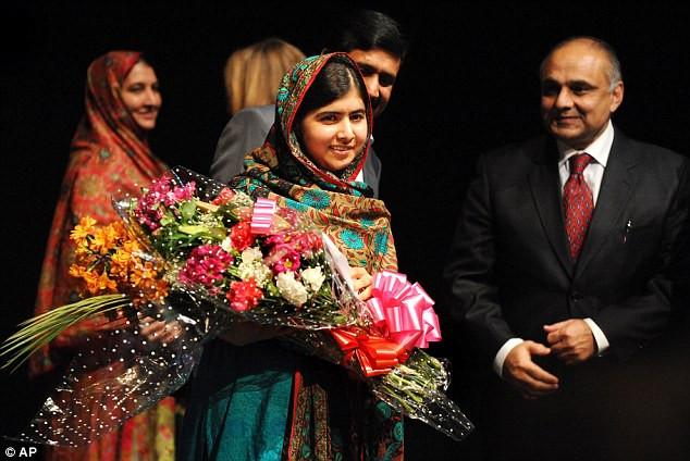 1412957680634_wps_64_Malala_Yousafzai_holds_fl.jpg