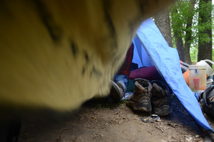 """Clark has a few sleeping bags, but only one blanket in his tent to sleep with every night. Even though it may seem small to some, Clark said this is all the space he needs. """"I've got a place to put my boots and I've got a place to lay my head at night,"""" he said. """"What else could a man ask for?"""""""