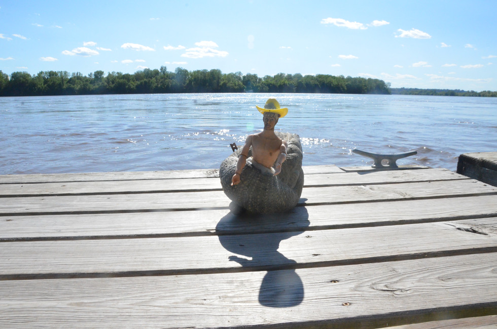 Quirky and modified Barbie dolls are scattered around the grounds. This one in particular is half of a Ken doll glued to a duck body. One resident said he even floats.