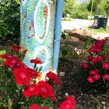 Cooper's Landing is adorned with flowers and unique artwork around the grounds.
