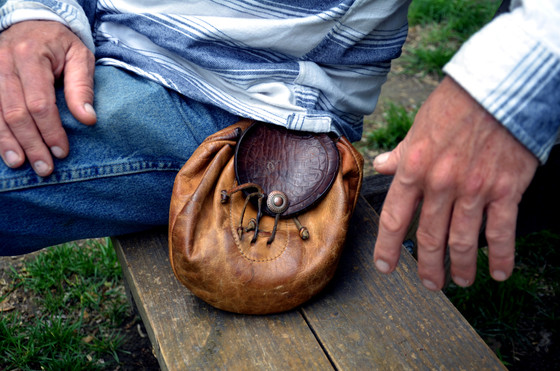 Part of Clark's daily attire is a leather pouch he keeps around his waist like a belt. Some essentials he keeps in his pouch are a pocketknife, a pipe and his cellphone.