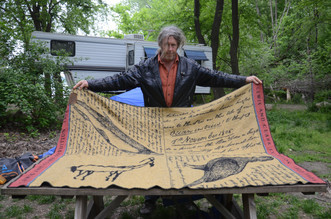 Clark displays one of his most prised possessions: his blanket given to him by a fellow river man.