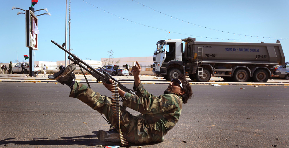 A Libyan rebel try's to shoot down an attacking Libyan air force plane that bombed his position minutes earlier, Ras Lanuf, Libya, 07 March 2011.