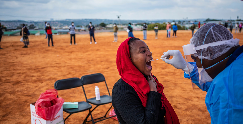 A women gets tested by a health care professional during a local government mass testing deployment in the high density Alexandra township on day 32 of the national lockdown as a result of Covid-19 Coronavirus, Johannesburg, South Africa, 27 April 2020.   Stage 5 lockdown is due to end 30 April 2020 when stage 4 will be implemented.