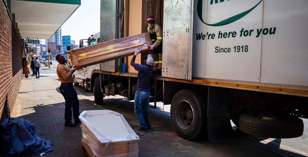 A delivery truck off loads more coffins at the Avbob undertakers Germiston branch  on the 116 day of lockdown due to the Covid-19 Coronavirus, Johannesburg, South Africa, 21 July 2020. Avbob has its own centralized coffin factory in Bloemfontein that delivers coffins to its hundreds of branches around the country.