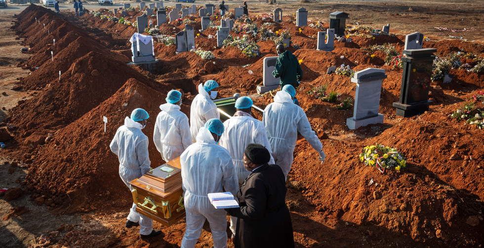 Family members wearing full PPE suites carry the remains of their beloved elderly family member who died as a result of the elderly Covid-19 Corona virus at a graveyard on the 119 day of lockdown due to the Covid-19 Coronavirus, Johannesburg, South Africa, 24 July 2020. The un-named elderly lady was 84 years old and died at a state Hospital. South Africa has just reached the 450 000 infection mark from the pandemic accounting for almost two thirds of all cases registered to date in Africa and the fifth country with the highest number of infections worldwide.