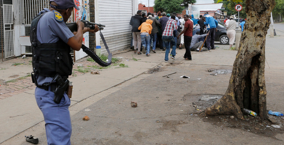 South African policemen fires at residents who are allegedly involved in looting and clashes with foreign residents during a xenophobic march by the Mamelodi Concerned Residents through the streets of Pretoria, South Africa, 24 February 2017. South African police on 24 February dispersed a xenophobic protest that led to violent attacks against immigrants in Pretoria. This new wave of violence came days after Johannesburg and Pretoria citizens set businesses belonging to Nigerian immigrants on fire, as they believed the latter were selling drugs and prostituting young local women.