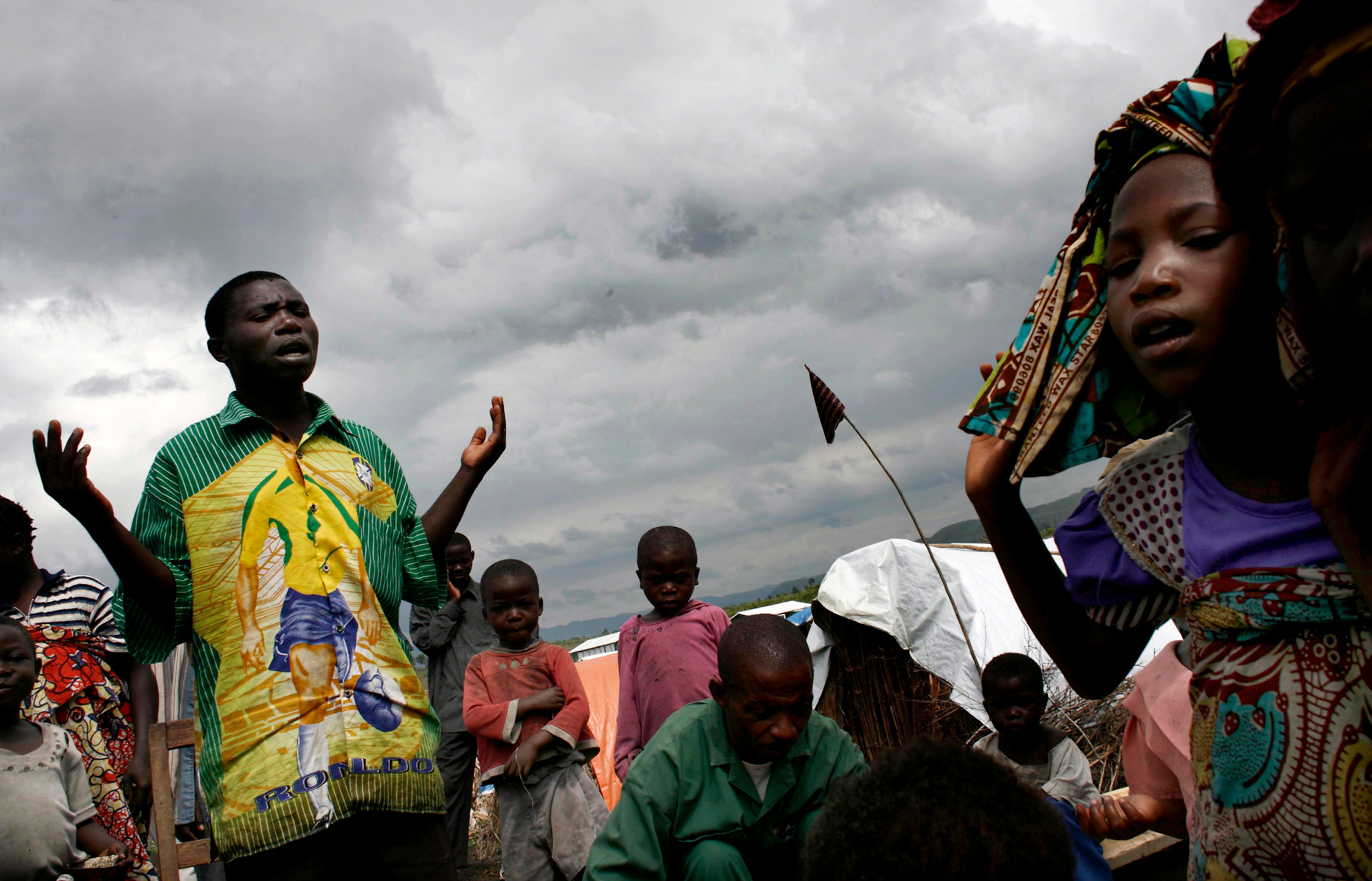 Praying for help, DR Congo.