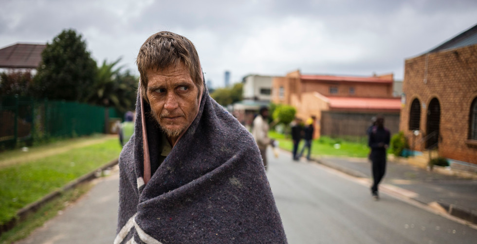 Homeless man Owen Barnard stands in the middle of the road looking for food on day 2 of the  national lockdown following President Cyril Ramaphosa declaration of a National Disaster as a result of Covid-19 Coronavirus of Covid-19 Coronavirus, Johannesburg, South Africa, 28 March 2020. Owen like thousands of others living on the streets of Johannesburg are in a precarious position as they are being told to leave the streets by police forces however there are not enough shelters to support them. Thousands of South African's living on the fringes of society have been drastically effected by the national lockdown that has lasted months. Most effected are the homeless, drug addicts and those people living in shanty towns.