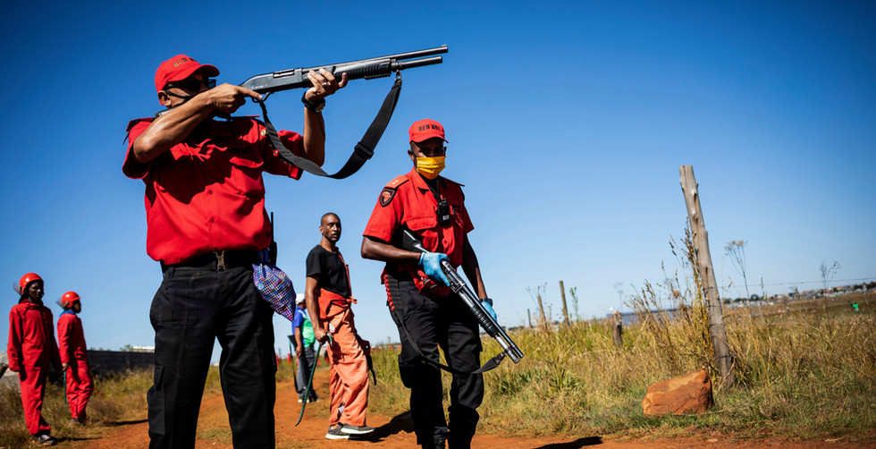Members of the Red Ants fire shot guns at protestors during running battles during the eviction of people from shacks on day 26 of the national lockdown following President Cyril Ramaphosa declaration of a National Disaster as a result of Covid-19 Coronavirus, Johannesburg, South Africa, 21 April 2020. The city of Johannesburg ordered the evictions of people who had erected shacks on illegally occupied land. This is contravention to the national lockdown laws stating that no evictions should take place during the strict national lockdown. Lockdown is due to end 30 April 2020.
