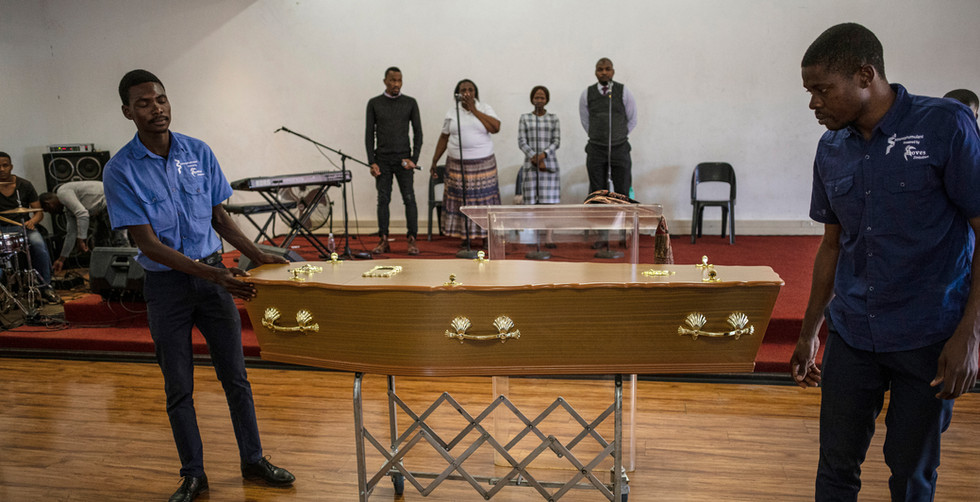 The body of slain Zimbabwe national, Isaac Setholi, during a short service before his body was repatreated back to Zimbabwe with his family and other refugees at a refugee camp, in Johannesburg, South Africa, 12 September 2019, set up for those affect by the recent violence against foreign nationals living in the country. The majority of people in the two camps in the eastern township of Katlehong are from Zimbabwe, Malawi and Mozambique. many of them where repatriated on 12 September with busses and trucks taking them back to their country of origin.