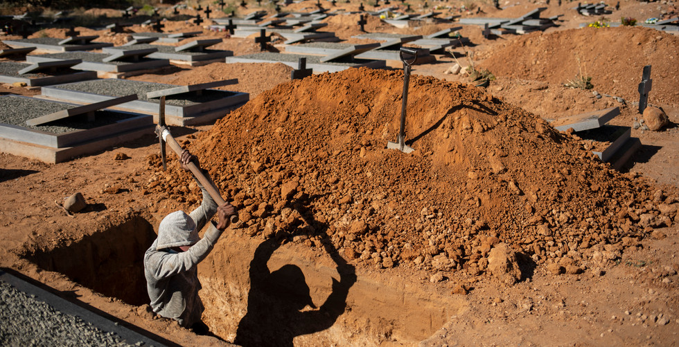 Local grave digger, Romio Bardman, digs another grave in the local towns grave yard Graaff Reinet, South Africa, 12 June 2020. Romia has seen 3 Covid-19 Corona virus victims buried in this grave yard. The deceased have to be buried within 3 days of dying. Romia digs normal graves the depth of his shoulders but has to dig corona graves above his head. The virus has taken many more lives in this huge, open and dry expanse of South Africa.