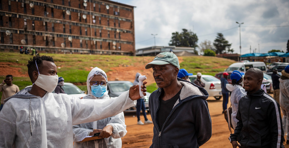 A man gets his temperature tested by a health care professional during a local government mass testing deployment in the high density Alexandra township on day 32 of the national lockdown as a result of Covid-19 Coronavirus, Johannesburg, South Africa, 27 April 2020.   Stage 5 lockdown is due to end 30 April 2020 when stage 4 will be implemented.