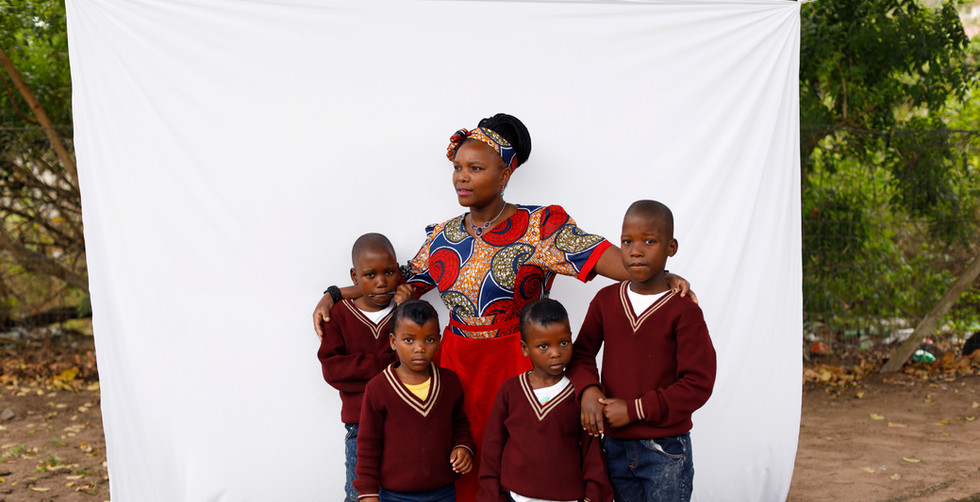 Mother with 2 sets of twins.