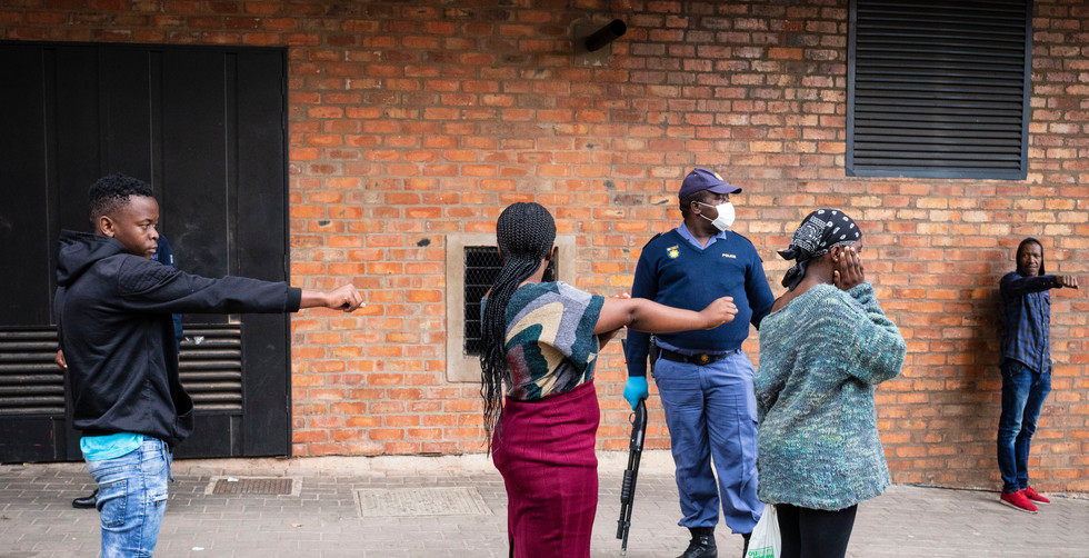 Members of the SAP (South African Police Force) instruct citizens to stand in line according to the social distances regulations on day 2 of the 21 day national lockdown following President Cyril Ramaphosa declaration of a National Disaster as a result of Covid-19 Coronavirus of Covid-19 Coronavirus, Johannesburg, South Africa, 28 March 2020. South Africa Police forces paroled the streets in downtown to enforce the rules and regulations of the lockdown. The national lockdown declared by President Ramaphosa on 23 March 2020 will start Thursday 26 March 2020 at midnight and continue for 21 days.