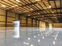Grind concrete, patch, epoxy coating