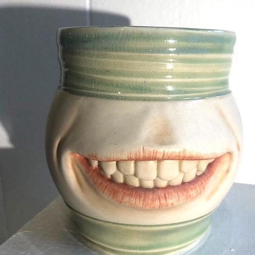 SMUG MUG (toothy grin)