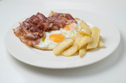 Fried eggs with Bacon and chips
