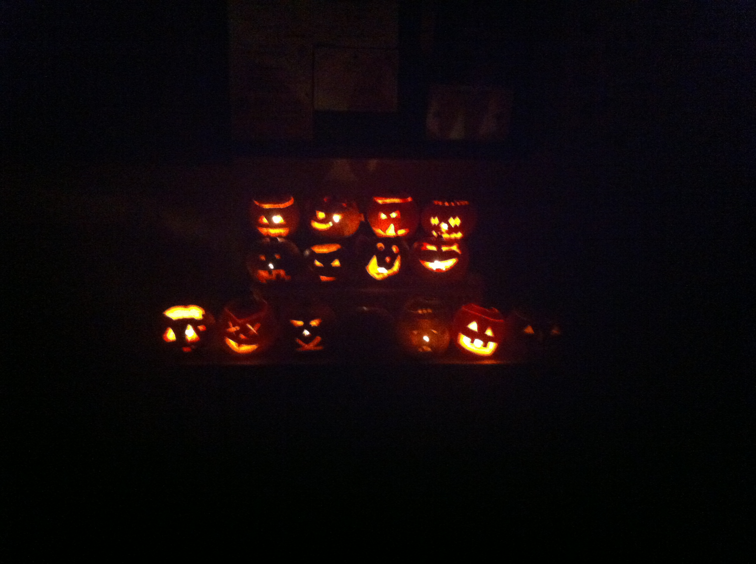 Carved pumpkins by night