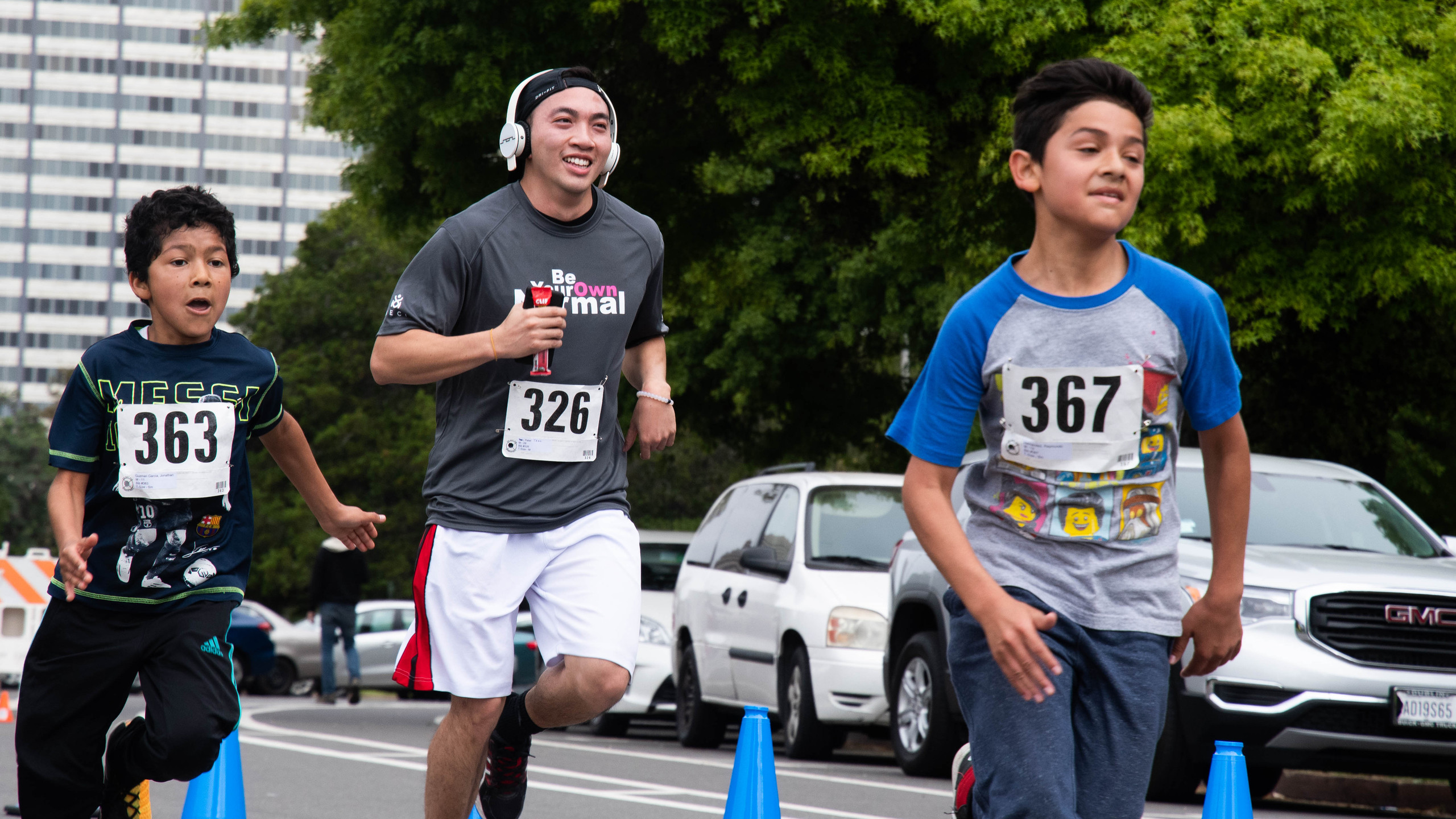 Three young people running