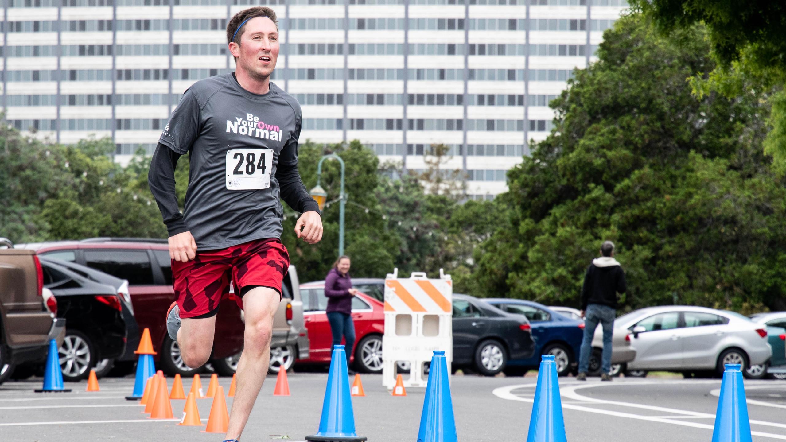 Man running in a race outside