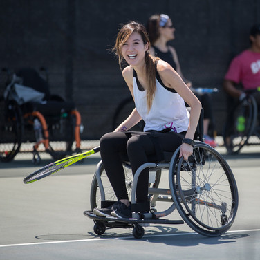 A girl playing wheelchair tennis