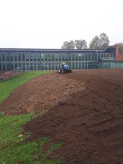 Levelling ground for turf