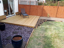 Decking, purple slate chip and treated wood sleepers