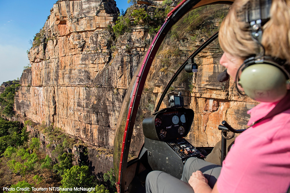 Lady in helicopter over Kakadu National Park NT
