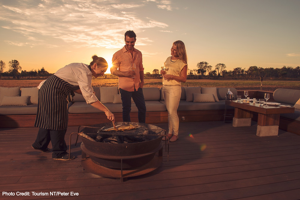 Cooking BBQ at sunset at accommodation in Kakadu National Park, Northern Territory Australia