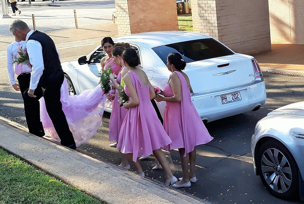 The Bride and her Bridesmaids arrive at the wedding
