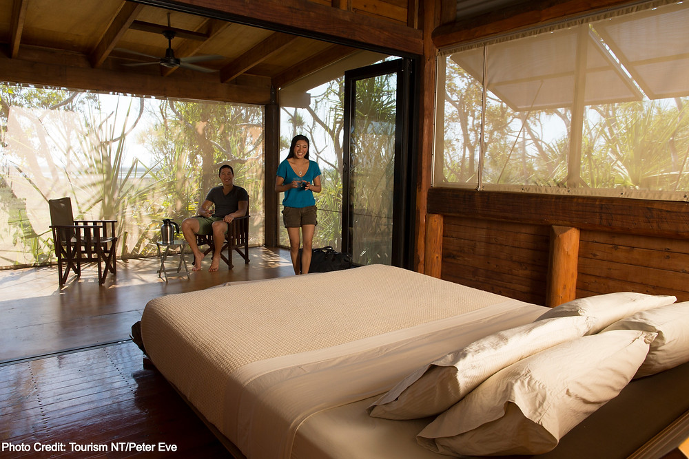 Couple looking at bed at accommodation in Kakadu National Park, Northern Territory Australia