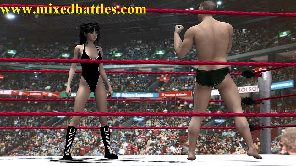woman vs man in the wrestling ring before fighting stances
