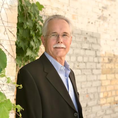 Dr. Brad Lemke