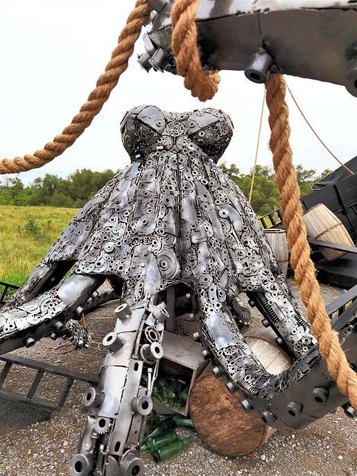 octopus, pirate ship, kraken, metal sculpture, metal art