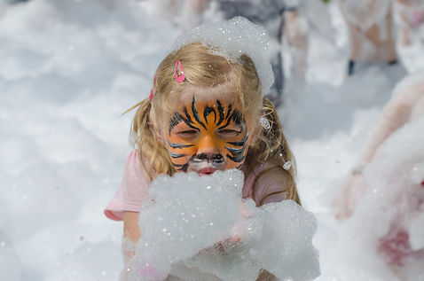 kid with tiger face painting in foam.jpg
