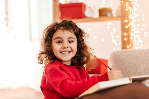 excited-kid-drawing-with-smile-indoor-sh