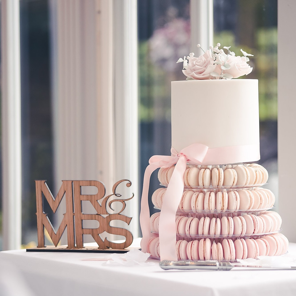 Pink macaron wedding cake by The Little Kendal Cakery
